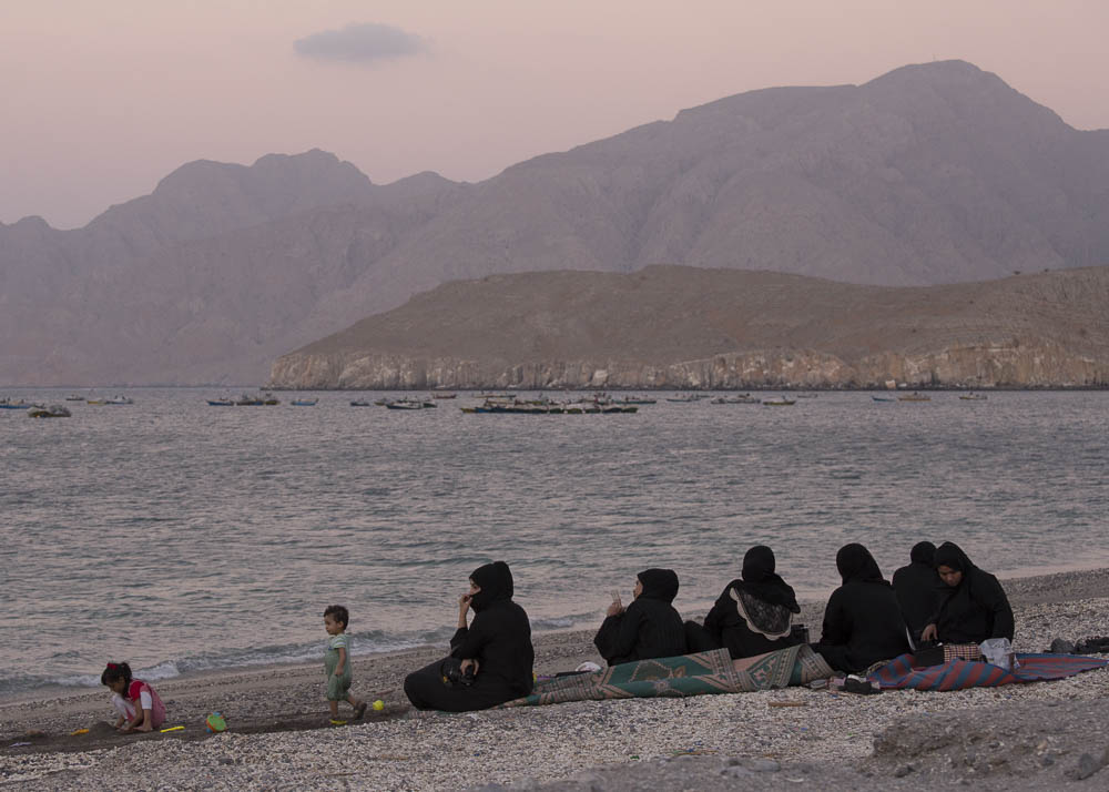A group of Omani women and their children enjoy a beach along the Strait of Hormuz.