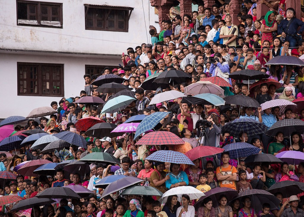 Crowds wait for hours to catch a glimpse of the Royal Kumari during the Indrajatra Festival in Kathmandu. The Kumari makes one of her rare public appearances at the festival.