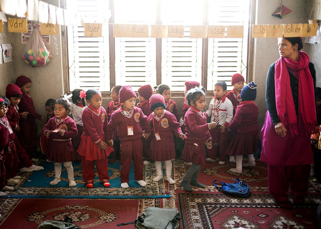 Dangol Kumari (front row second from left) leads a more typical life than the Patan Kumari or Royal Kathmandu Kumari. Dangol is seen attending school here in 2011. Her outfit is slightly different than the other students as she always wears red.